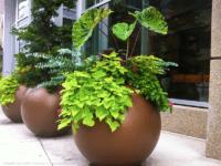 Round bronze planters