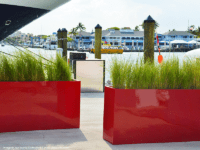 Bright red planters on a dock